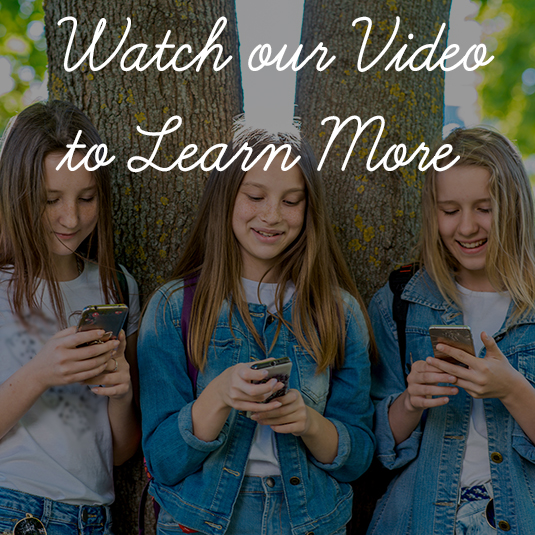 Three girls schoolgirl teen. In summer park by tree. On School change. In hands holds smartphone. The concept children in social networks, Internet, writes message parents. Emotions and happy smile.
